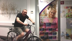 In the picture you can see Denise's CEO virtually cycling to Burma